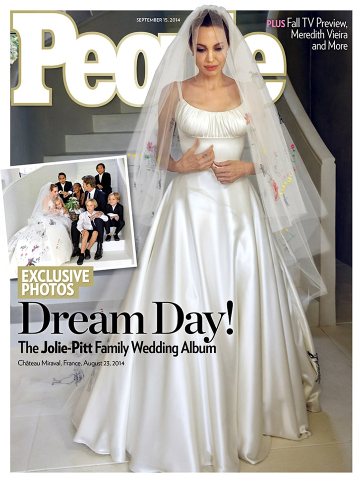 Angelina Jolie wears a classic satin gown during her Aug. 23 wedding to Brad Pitt in France. The gown, and veil, were customized with sewn-in drawings of the couple's six children.