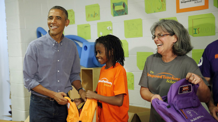 U.S. President Barack Obama helps fill backpacks with items to give to homeless children while participating in a service project at The Inspired Teac...