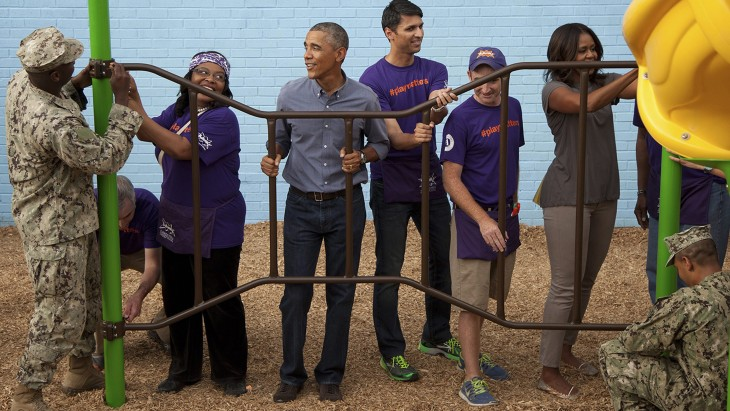 epa04396547 US President Barack Obama (C-L) and his wife Michelle Obama takes part in a service project at the Inspired Teaching School to commemorate...