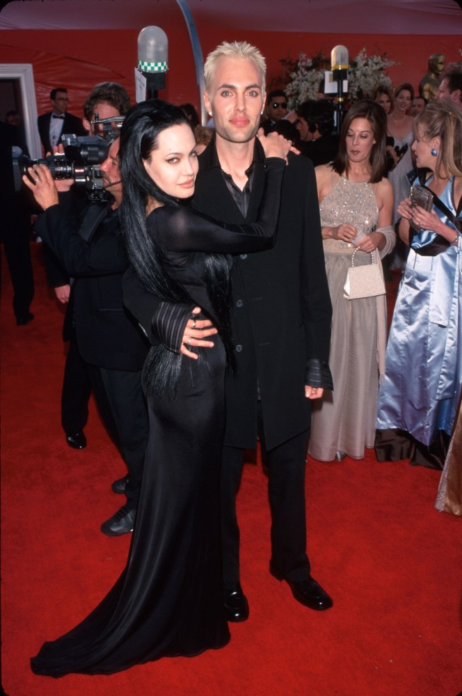 Actress Angelina Jolie, wearing black gown, and brother James Haven at Academy Awards.  (Photo by Mirek Towski/DMI/The LIFE Picture Collection/Getty I...