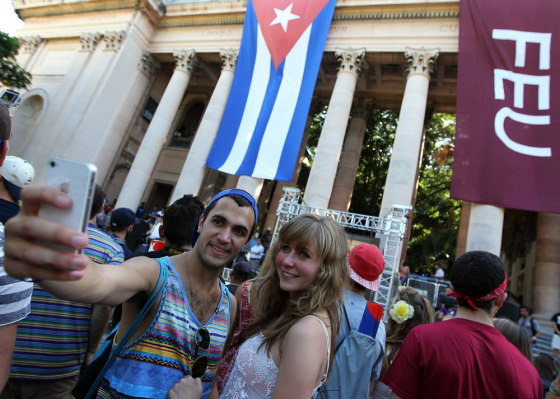 Two students take photographs in front of Havana University after arriving in Cuba on Monday aboard the MV Explorer cruise ship.