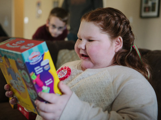 Cibolo, Tx., December 11. 2013: Alexis opens gifts surrounded by her family at her 12th birthday celebration. Alexis Shapiro, 12, had a brain tumor re...