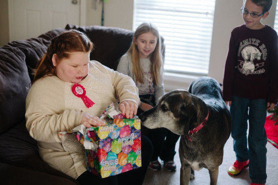 Cibolo, Tx., December 11. 2013: Alexis opens gifts on her 12th birthday under the watchful eyes of her sister Kayley, 9, brother Ethan, 7, and dog Bab...