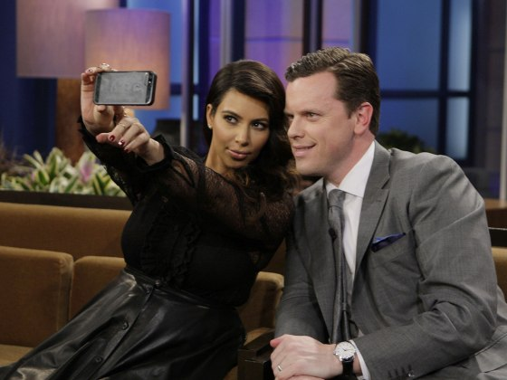 "Kim Kardashian uses her iPhone to take a photo with TODAY's Willie Geist on the set of ""The Tonight Show with Jay Leno."""