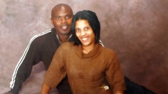 Anderson, here with his wife, LaQonna, has said he never ran from the law.