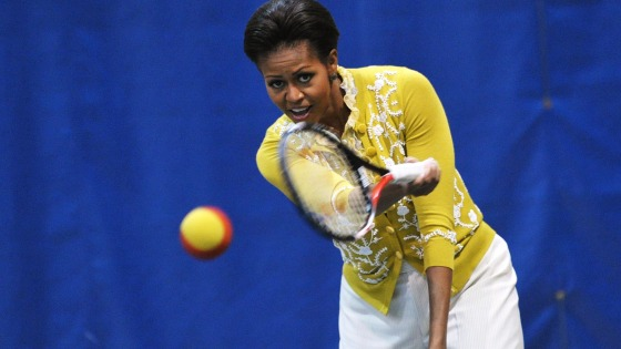 US First Lady Michelle Obama plays tennis while attending a mini-Olympics event with local school children at American University's Bender Arena March...