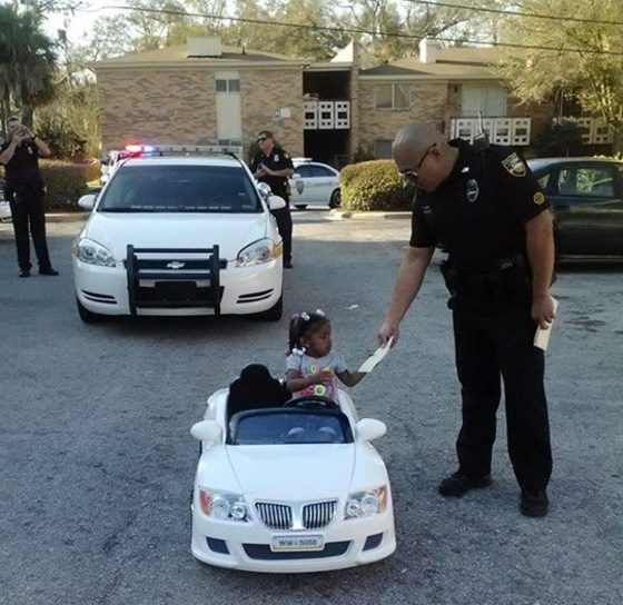 Cop Photo Goes Viral: Photo Of Toddler In Toy Convertible Getting Ticket From