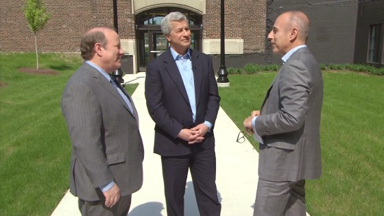 "Detroit Mayor Mike Duggan (left, with Dimon, center and Lauer), called the investment ""a significant start."""