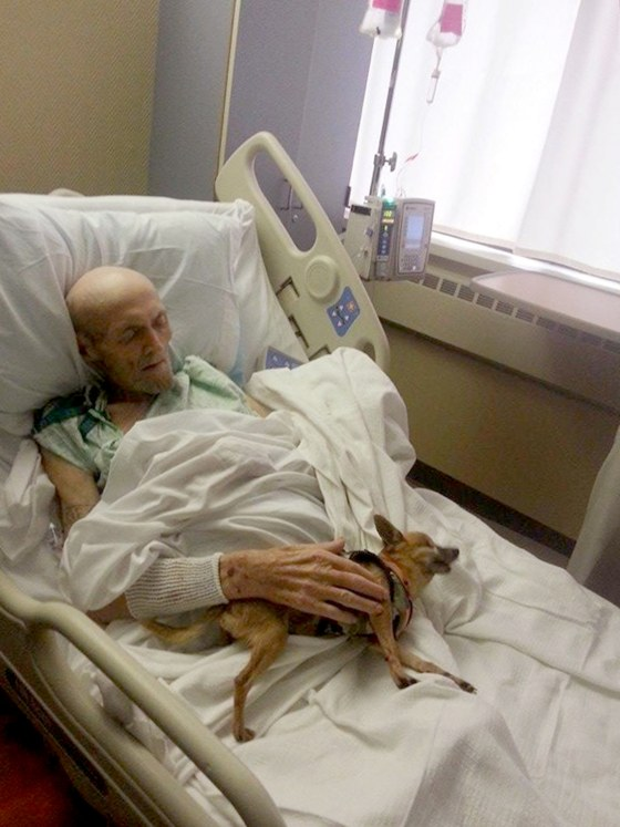 James Wathen rests with his dog, Bubba, after their second reunion since Wathen was hospitalized.