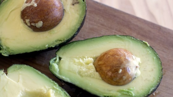 This Dec. 15, 2014 photo shows avocados in Concord, N.H. There are multiple ways to serve up guacamole for the Super Bowl. (AP Photo/Matthew Mead)