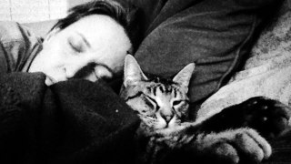 After his rescue, Linus the cat (pictured here with mom Debbie), slept for two days.