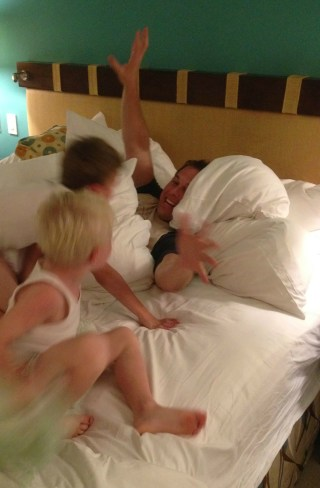 Omer Cedar has a friendly pillow fight with sons Eli and Sam.