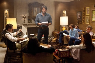 "This film image released by Warner Bros. Pictures shows Ben Affleck as Tony Mendez, center, in ""Argo,""  a rescue thriller about the 1979 Iranian hosta..."