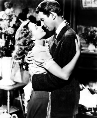 "Donna Reed and Jimmy Stewart in 1946's ""It's A Wonderful Life."""