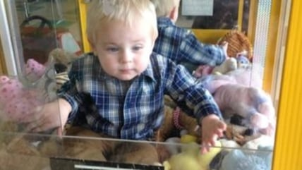 Toddler in claw machine
