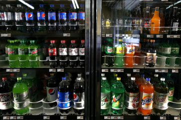 Image: Various bottles of soda are displayed in a cooler at Marina Supermarket on July 22, in San Francisco, Calif.