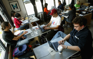 Customers at the Canvas Cafe in San Francisco take advantage of free wi-fi.