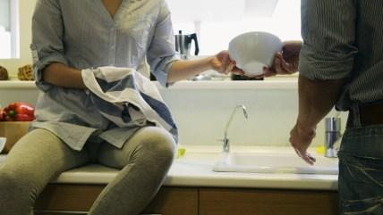 Couple washing dishes together (PhotoAlto via AP Images)