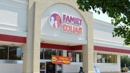 In this Tuesday, July 29, 2014 photo,  customers enter a Family Dollar store on Plaza Boulevard, in Kinston, N.C. There's now a bidding war for Family...