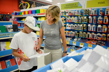 Mother shops for Back to School with her son.