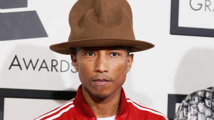 Musician Pharrell Williams and wife, Helen Lasichanh, arrive at the 56th annual Grammy Awards i