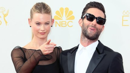 LOS ANGELES, CA - AUGUST 25:  Model Behati Prinsloo (L) and husband singer Adam Levine attend the 66th Annual Primetime Emmy Awards at the Nokia Theat...