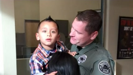 Officer and boy who was choking