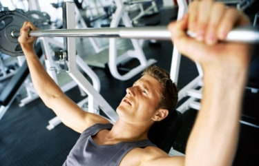 High angle view of a mid adult man lifting weights in a gym. Stock photo photography msnbc exercise workout