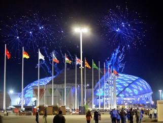Fireworks are seen as spectators arrive for the rehearsal of the Opening Ceremony at the Fisht Olympic Stadium at the 2014 Winter Olympics on Feb. 1, 2014 in Sochi, Russia.