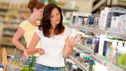 Shopping series - Brown hair woman in cosmetics department holding bottle of shampoo; Shutterstock ID 30637030; PO: today.com