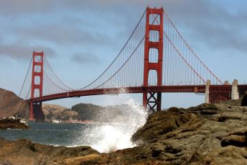 Waves crash against a rock near the Golden Gate Bridge on Aug. 23, 2007, in San Francisco, California.