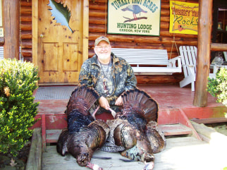 Marlin Watkins with wild turkeys bagged at Turkey Trot Acres.
