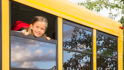 Little Schoolgirl looking through a Schoolbus Window; Shutterstock ID 110490320; PO: Today.com