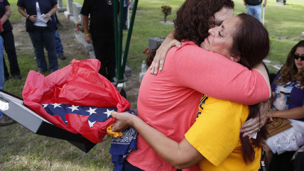 Patsy Maciel, right, the mother of Lance Cpl. Fred Maciel, who died in a helicopter in Iraq more than nine years ago, embraces Lanie Brown as she hold...