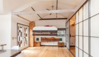 The bed in Vincent Kartheiser's tiny bungalow hangs from the ceiling with a pulley system.