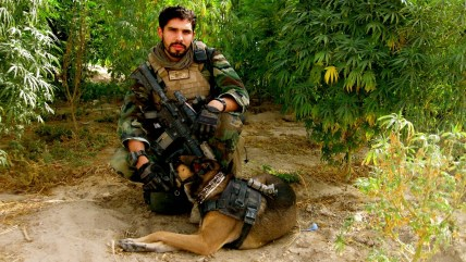 Staff Sgt. Christopher Diaz, pictured with Dino, his military dog.