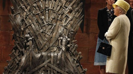 Britain's Queen Elizabeth looks at the Iron Throne as she meets members of the cast on the set of the television show Game of Thrones in the Titanic Q...
