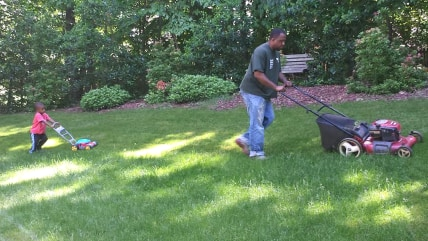 Chris Watkins and son Blake do some tandem mowing.