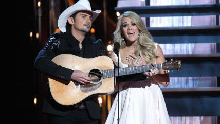 IMAGE: Hosts Brad Paisley, left, and Carrie Underwood
