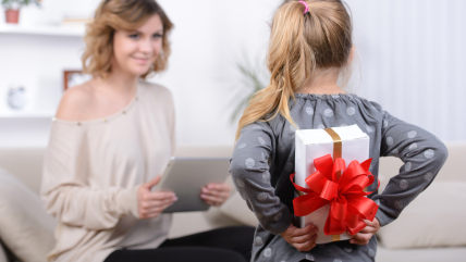 Little beautiful pretty girl giving a gift to her happy mother - indoors; Shutterstock ID 197392076; PO: TODAY.com