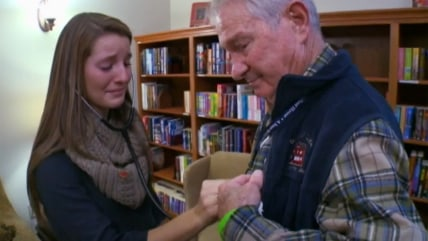 Casey Heisler hears her brother's heart beat in the chest of Tom Meeks.