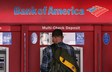 A customer uses a Bank of America ATM.