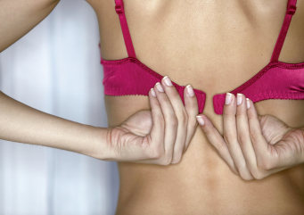 Womans Hands Fastening Bra --- Image by © Comstock Select/Corbis stock, msnbc, photography