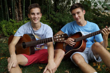 German exchange student Simon (left) and host brother Garrett, both 16, play soccer together and have formed a band.