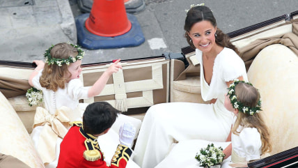 LONDON, ENGLAND - APRIL 29:  Maid of Honour Pippa Middleton with brides maids and page boy make the journey by carriage procession to Buckingham Palac...