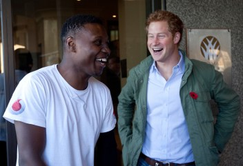 Image: Prince Harry meets former Royal Marine Commando Ben McBean, as he completes his 31-mile run through London.