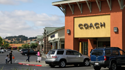 In this photo taken on June 11, 2009, a group of people make their way toward stores at the Napa Premium Outlets in Napa, Calif.