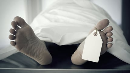 Closeup of foot in a morgue with blank tag hanging from the big toe.; Shutterstock ID 36734245; PO: TODAY.com