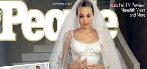 Angelina Jolie wears a satin gown at   her wedding to Brad Pitt on Aug. 23 in France. The gown and veil were customized with drawings of the Jolie-Pitt's six children.