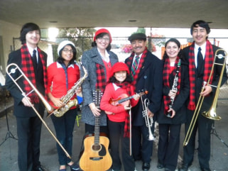 The five children in the Burgos family have all studied a musical instrument and excel in school. From left, Stephen, 20, Monica, 16, mom Maria Elena, Theresa, 11, dad Rene, Elizabeth, 22, and Martin, 18.